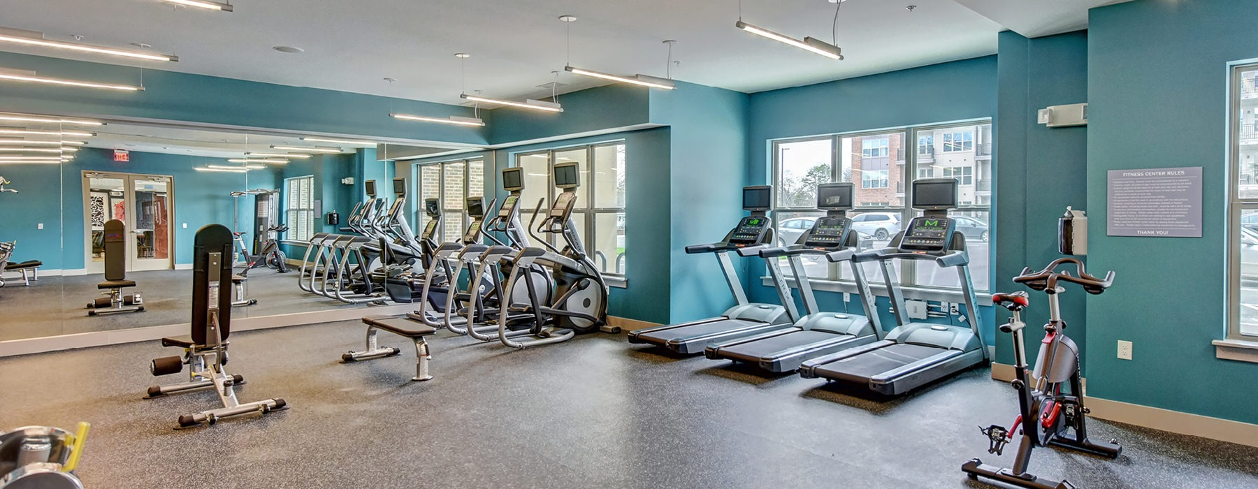 Fitness Center with light blue walls and a variety of equipment